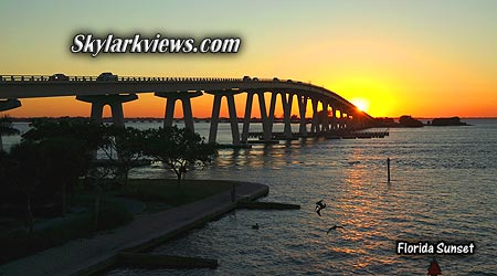 sunset behind the sanibel bridge